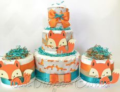 Woodland Fox Diaper Cakes in Teal, Orange and Gray, Fox and Friends 3 Tier Baby Shower Centerpiece, Woodland Theme Decorations by AllDiaperCakes on Etsy https://www.etsy.com/listing/245045093/woodland-fox-diaper-cakes-in-teal-orange