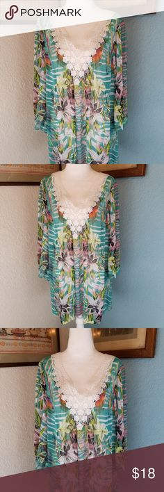 """Green Flower Crochet Neck Tunic Top Beautiful Green Flower Tunic Top with Crochet Neckline V-Neck.  Hand Wash and lay flat to dry.  Size XL. 26"""" long with 3 quarter length  Sleeves.  In gently used condition. Mushkaby Sienn Rose Inc Tops Tunics"""