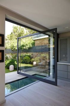 Modern House Design 84792 Bay window: 15 ideas for opening your home to the outside Interior Garden, Home Interior Design, Interior And Exterior, Interior Door, Walking On Glass, Pivot Doors, Sliding Door, Front Doors, Metal Building Homes