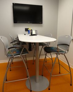 Ignore look and feel; we like the function of the room (TV, tall table and tall chairs for a huddle room or small conference) Tall Table, Dining Table, Chiropractic Office Design, Creative Office Space, Building Renovation, Corporate Office Design, Future Office, Break Room, Media Center