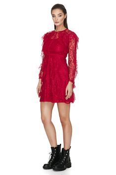 Lovely and elegant lace sheath dress from Vero Milano shows off alluring hints of skin.