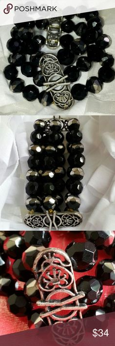 """BRACELET BLK 3 STRAND Striking multi-faceted black  beaded triple strand wide cuff bracelet.  The bracelet has two beautiful                     silver designs  of 1 1/2 """" connecting the triple strands in two places.  I have received many compliments wearing this bracelet.  Definitely a Statement Bracelet. Looks showcase new. One of my favorites. Jewelry Bracelets"""