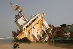 Large abandoned ships rust on Nigerian beach - Photos