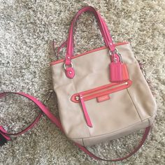 COACH SUMMER/SPRING TAN CROSSBODY HAND BAG LIKE NEW CONDITION  , CLEAN INSIDE AND OUT. BOUGHT SIMILAR BAG AND DONT WANT THIS ONE TO SIT IN CLOSET. Don't have measuring tape, took pictures with bag to estimate size. Coach Bags Crossbody Bags