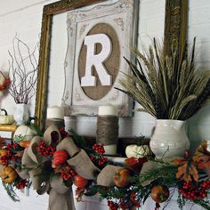 Mantel with Framed Monogram. dreamanddiffer.blogspot.com Twine two gourd garlands for more fullness, and add burlap bow.  Love it!