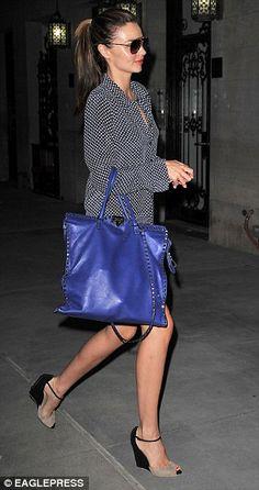 Electric blue: Miranda carried a Valentino Rockstud patent shopper tote bag