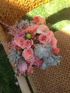 Top view of coral bridesmaids bouquet. Flowers by Travis Payne