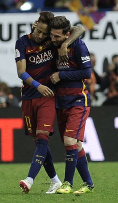 """Barcelona's Argentinian forward Lionel Messi (R) and Barcelona's Brazilian forward Neymar embrace at the end of the Spanish """"Copa del Rey""""…"""