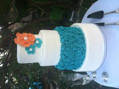 Turquoise and coral wedding cake with ruffles