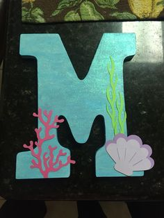 Aqua colored baby initial for my baby's 1st birthday under the sea theme. Under the sea name. Wood initial bought at Michaels