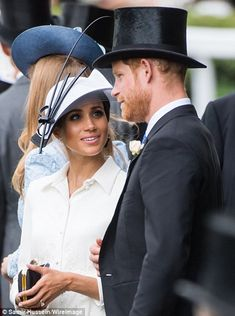 Meghan was seen looking up lovingly at Harry while at Ascot...