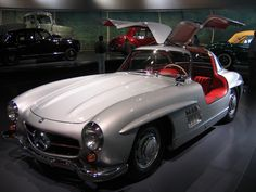 The Mercedes-Benz 300SL was introduced in 1954 as a two-seat, closed sports car with distinctive gull-wing doors. Later it was offered as an open roadster. It was the fastest production car of its day.