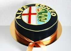 An Alfa Romeo cake, made for sweet-toothed Alfaholics!  (by czechcakes.com)