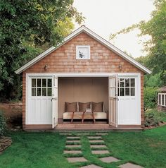 White doors and trim pair with wood shingle siding to create a charming exterior for this delightful guest cottage. Inside, comfortable furnishings ensure friends and family feel at home. Little House Plans, Small House Plans, Sketch Inspiration, Layout Design, Design Ideas, Small Cottage Designs, Cottage Ideas, Backyard Cottage, Backyard House