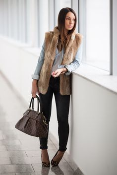 What a cute combo fur vest over denim, tshirt great statement necklace and animal print shoes.  Love it!