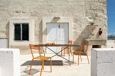 Flower is a colourful chair with an iconic design. It can be used in bars or terraces. Light and stackable, it is also available in folding version.  | @ethimofr #designbest #outdoor #italiandesign