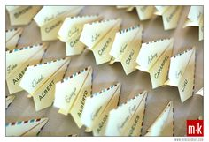 Origami airplanes as escort cards || Mimi and Karl – Real and Heartfelt Wedding Photographers » Blog Archive » Jeff and Edz (Mango Farm)