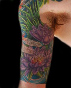 Lotus and dragonfly half-sleeve tattoo by Tegan Beyer at Body Graphics, Pennsauken, NJ