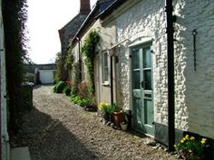 Cottage & Loke in Blakeney, North Norfolk. A Loke is a private path or road.