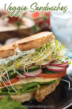 This sandwich is a convention of the freshest, most flavorful produce that summer can offer. Herbed Cream Cheese ties together tomato, cucumber, and radish slices, lettuce, and sprouts.