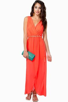 Feel like a goddess in this dreamy chiffon maxi dress featuring a surplice front and a layered skirt. Sleeveless. Cutout back. Elasticized waist with belt loops and a chain-link belt. Marrow finished hem. Fully lined.