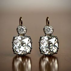 (Rare Collection) Antique & Vintage Earrings - Estate Diamond Jewelry - A beautiful pair of rare cushion cut diamond earrings. Available at Estate Diamond Jewelry. Silver Diamonds, Diamond Studs, Diamond Jewelry, Diamond Earrings, Stud Earrings, Buy Diamonds, Flower Earrings, Gemstone Jewelry, Silver Earrings
