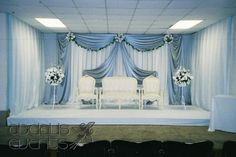 White fabric can be used for walls behind the seating of bride and groom,