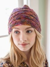 Fane by Berroco / free pattern: Textural bands of reverse stockinette run along the width of this cozy cap edged with ribbing.