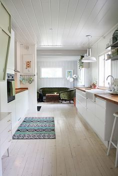 I love all the green details! and the wood countertops.