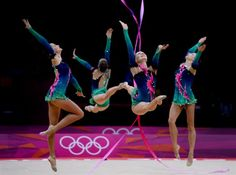 Belarus with three ribbons and two hoops during the Rhythmic Gymnastic Group all round qualification at Wembley Arena, London