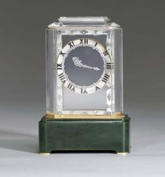 """ART DECO ROCK CRYSTAL, DIAMOND, MOTHER-OF-PEARL AND NEPHRITE """"MODEL A"""" MYSTERY CLOCK, BY CARTIER Ca. 1915"""