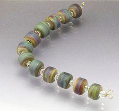 Handmade Raku bead set (12) small barrel beads brown glass beads teal beads violet lampwork glass beads Made to ORDER  Anne Londez  SRA
