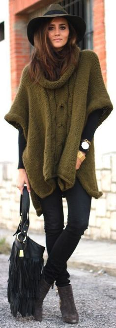 what to wear with a hat : knit poncho + black top + skinnies + boots + bag