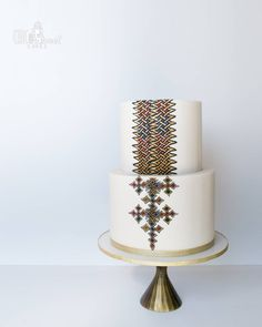 This cake was specially designed for a christening to match the traditional Ethiopian habesha dress. Got a chance to put my illustrator and… Traditional Cakes, Traditional Wedding, Africa Cake, African Wedding Cakes, Habesha Kemis, Ethiopian Traditional Dress, Ethiopian Wedding, Ethiopian Dress, Luxury Cake