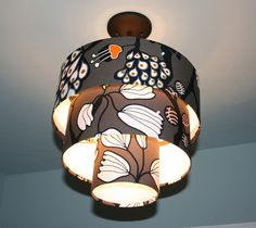Several lamps shades combined and covered with fabric to make this a very unique piece