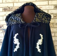 Irish Fleece Cape Embroidered With Silver Roses by TexasStitchWitches on Etsy https://www.etsy.com/listing/250917664/irish-fleece-cape-embroidered-with