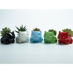 Bulbasaur Planter with plant Ceramic or Plastic ($29) ❤ liked on Polyvore featuring home, home decor, floral decor, plastic planters, ceramic home decor, ceramic planters and black and white home decor
