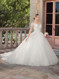 If you dream of going to great lengths for your bridal style, Gracie is the gown for you. With a royal length train that extends elegantly down the aisle, ...