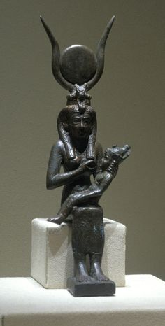divine mother Isis and her son Horus                                                                                                  Creation date  64-332 B.C                                                                                      Materials  bronze, silver