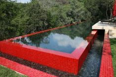 You can't ignore this assertive red pool — it punches up a natural landscape setting and dramatically defines the space