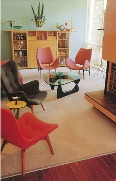 Bright colours are a strong feature of post war interiors with feature walls of different colours and materials