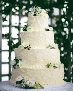 Fresh flowers made this four-tiered vanilla, Italian-meringue, buttercream cake suitable for an elegant outdoor reception.