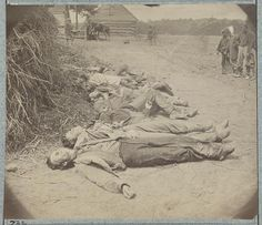 Confederate dead laid out for burial near Mrs. Alsop's house, Spotsylvania. O'Sullivan, Timothy H. May 20, 1864.