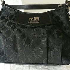 Coach Shoulder bag Brand New still in the Macy's Box who is an authorized seller for Coach.  Never used.  Doesn't come with tags as it was a gift.  Has blue lining inside Coach Bags Shoulder Bags