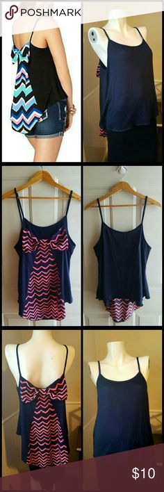 """Business in the front & Party in the back Tank Top Colors: Navy Blue & Pink.   NWT. Hi-low style hemline. Traditional tank top in front with fun pink & Blue bow tie in back.   Measurements  Bust 38"""" - 40"""" Waist 31.5"""" - 33.5""""  Front length 17.5""""  Back length 21""""   Get an additional 30% off when purchasing 3 or more items using the bundle feature. Always willing to negotiate. 🌼🌹🌼🌹🌼🌹🌼🌹🌼🌹🌼🌹🌼🌹 Tops"""