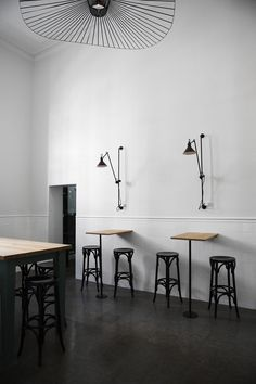Bar and Co. restaurant | Design Within Reach Lampe Gras 214 Wall Lamp