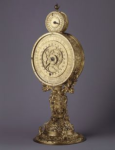 Monstrance clock, 1570. In addition to showing the hours, the astrolabe dial of this clock (parts of which are now missing) was made to indicate the apparent motions of twenty-three stars in the northern hemisphere, the position of the sun and the moon in the zodiac, and the age and phase of the moon in its monthly cycle