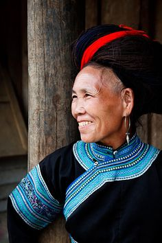 Vietnam   Portrait of a White H'mong hill tribe woman with distinctive big hair and traditional clothing, in Muong Hum market near to Sapa   © Kimberley Coole