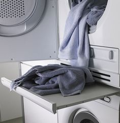 pull-out table between washer and dryer.to me, this is a no-brainer if u have stacking w/d. Pull Out Shelves, Stacked Washer Dryer, Washer And Dryer, Washing Machine, Stockings, Washing And Drying Machine, Washer