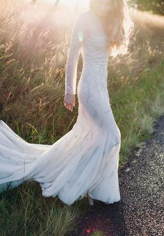 long sleeve mermaid wedding dress in field